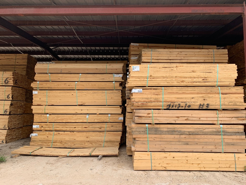 wholesale lumber stacked up by The Pallet Guys
